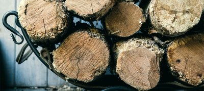 Woodlogs in basket. Photo.